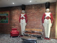 A pair of FAO Schwartz tin soldiers with automotive-part furniture